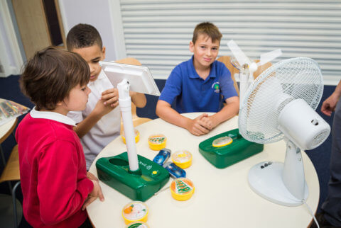 """ECO"""" smart education showing pupils with a completed project building a wind turbine"""
